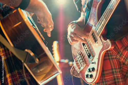 Guitarist and bassist pop musicians during a group performance. - 243449408