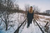 Lonely woman walking in park in winter. - 243453670