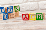 Wooden toy Blocks with the text: acb - 243456035