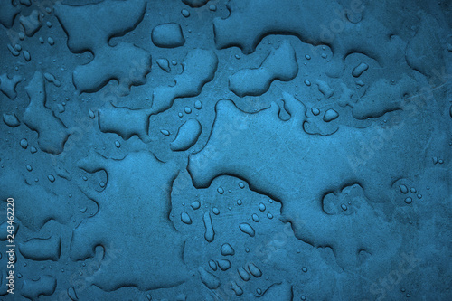 various patterns formed by water drops on a sheet of metal closeup