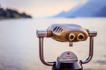 Tourist binoculars on the coastline of Lago di Garda, Italy