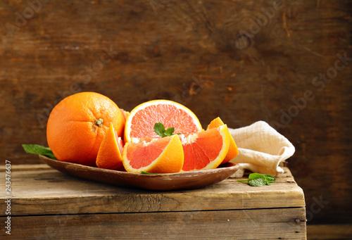 ripe organic red orange on wooden background