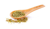 dry oregano leaves on bamboo spoon and on white background - 243482452