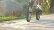 Girls ride bicycles. Setting sun. Clear sunny. A close-up of the park bike in the morning.HD 1080p, slow motion 120 fps, high speed camera.mp4