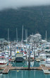 Whittier, Alaska, USA - September 13, 2013: Whittier harbor and marina surrounded by high mountains