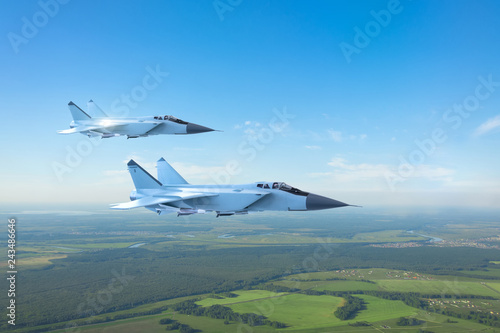 obraz PCV Couple military jet fighter aircraft, flying above ground