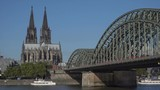 Directional signs in front of Cologne Cathedral and hohenzollern bridge, Germany - 243487406