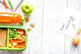 kid menu lunchbox for school top view on wooden background - 243487847