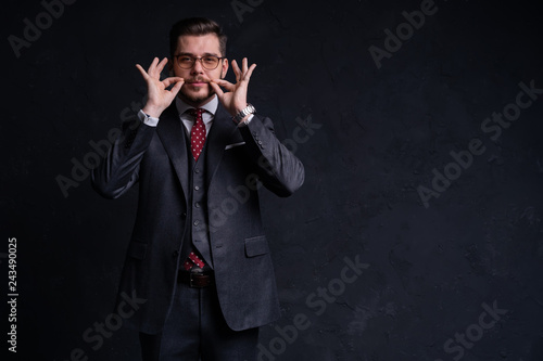 Leinwandbild Motiv Elegant young handsome man. Studio fashion portrait