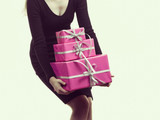 Girl carrying many pink gift boxes - 243496295