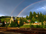 Fototapeta Tęcza - Twin rainbow over Carpathian mountain village. Eastern Carpathians, Ukraine © Roden_W