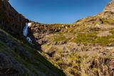 Waterfall over Trollstigen mountain road, Norway