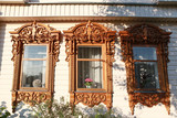 Windows with carved frames on wooden house in Suzdal city (Russia)