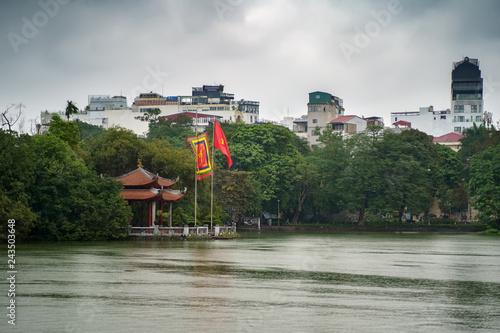 Foto Murales Ngoc Son Temple. Hanoi city old town. Vietnam cityscape at rainy day