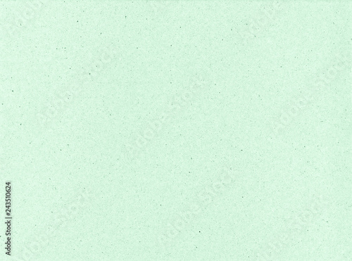 Texture of cardboard closeup, light green abstract paper background.