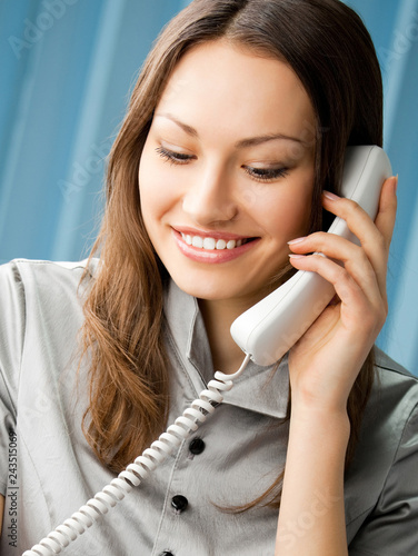 Young business woman with phone at office © vgstudio
