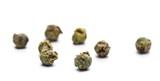 Dry green pepper pile, macro peppercorn isolated on white - 243523241