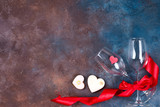 Composition with wine glasses, ribbon and decorative hearts on stone background with copy space, flat lay. - 243531802