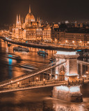 Panorama of the Hungarian Parliament, and the Szechenyi Chain bridge over the River Danube, Budapest, Hungary, at night