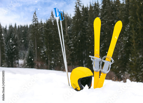 Leinwandbild Motiv Ski equipment in snow outdoors, space for text. Winter vacation