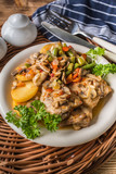 Fillet of chicken legs with stewed vegetables. - 243536666