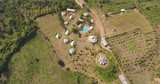 aerial overhead of a bamboo resort with an outdoor swimming pool - 243538897