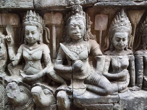 Apsara dancers in Angkor Wat on the wall of Leper king temple.