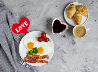 Tasty Fried Egg in the Shape of a Heart Served on a White Plate with Bacon Tomato Basil Pepper Gray Background Valentine Day Breakfast