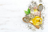 Seeds of sesame and sesame oil. On the old background. Top view. Free copy space. - 243558067