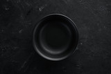 Clay dishes. A plate on a black background. Top view. Free copy space. - 243559603