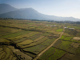 Aerial view of rural landscape in central Nepal. Paddy fields and hills in winter. - 243561694