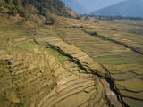 Aerial view of rural landscape in central Nepal. Paddy fields and hills in winter. - 243561886