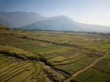 Aerial view of rural landscape in central Nepal. Paddy fields and hills in winter. - 243561889