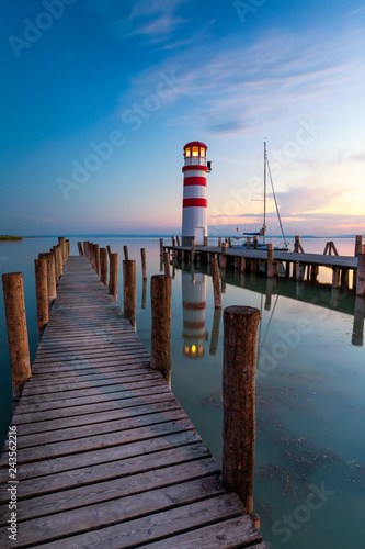 Leinwanddruck Bild Lighthouse at Lake Neusiedl at sunset near Podersdorf, Burgenland, Austria