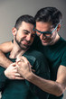 Sexy young gay couple in love, embracing and hugging each other