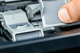 ink cartridge replacement on an inkjet printer - 243575853