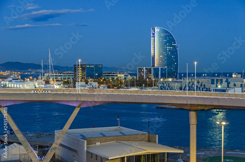 Port Vell with its cruise terminal, bridge Porta d'Europa, Nautic Center and W Barcelona at night