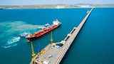 tanker moored to the port using tugs - 243581099