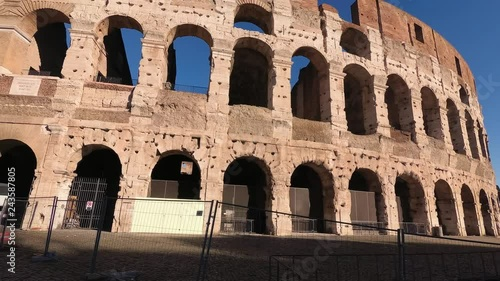 Italy, Rome, moving orbital view from outside of the Archs of the Coliseum, A sunny winter morning