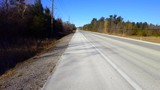 Viewpoint of Rural Road With Scarce Traffic in Daytime.  Street View of Near Vacant Country Street in Day. - 243588431