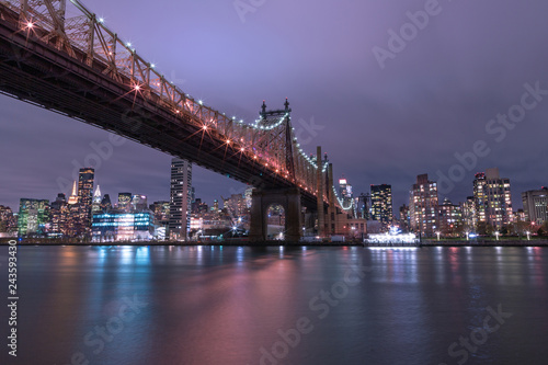 Wall mural View on Queensboro bridge and Midtown Manhattan  from east river at night with long exposure