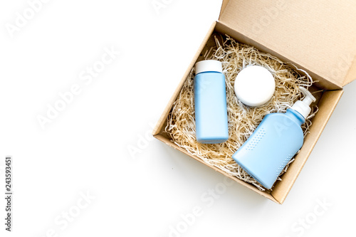 Delivery. Cardboard box with cosmetics on white background top view copy space