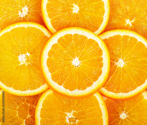 Slices of ripe oranges arranged in the image