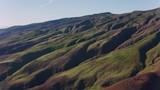 Maui, Hawaii circa-2018.  Aerial view of mountainous terrain on Maui.  Shot with Cineflex and RED Epic-W Helium.  - 243602856