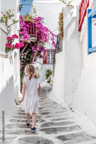 Little girl walking the narrow alley in Greece