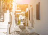 Narrow street with white houses, Greece - 243607828