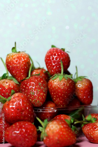 Strawberry on glitter blue background and have space for write wording, sweet romantic fruit for special person, lovers in Valentine day, make many dessert menu or juice or dairy strawberry flavor
