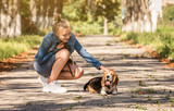 Blond girl sitting with puppy - 243609002