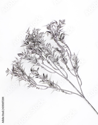 festive decorative silver branch on a white background