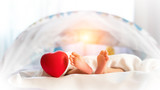 Baby foot and red heart on white - 243617824